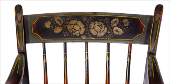 floral painting on green painted crest rail of Windsor chair