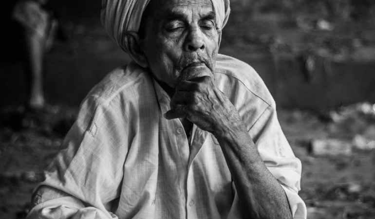 grayscale photo of man wearing turban