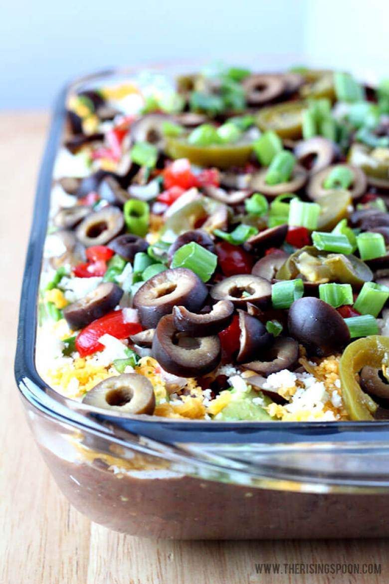 You may not want to eat this 7 layer bean dip because it looks so pretty on a snack table.