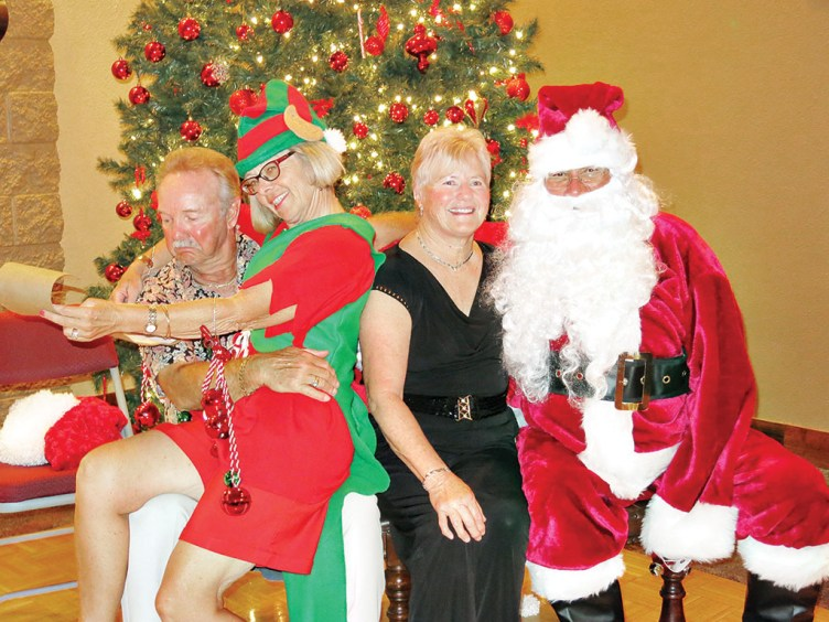 Dale Stokke can't believe that he is on the Naughty List again this year! With elf Marcie Hogan, Diane Stokke, and Santa (Steve Cockrell).