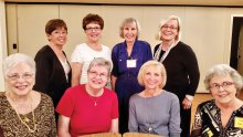 Fashion show models: Front row: Esther, Debbie, Jan and Sandy; back row: Winnie, Joyce, Rita and Ursula