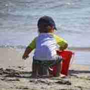 Toddler on beach.