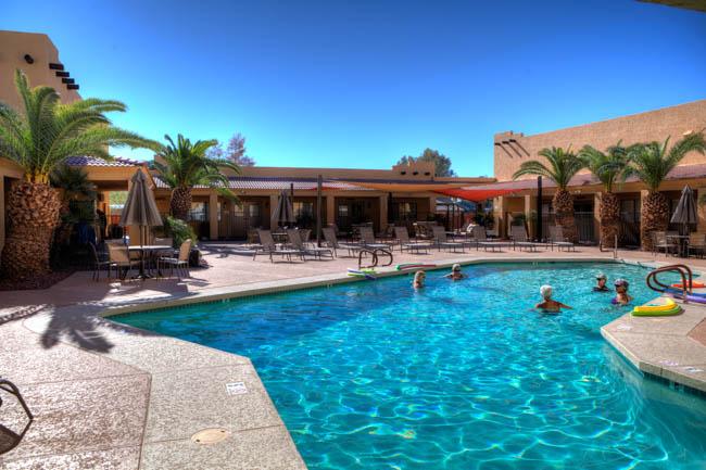 Residents enjoying the pool at Sundance 1 RV Resort