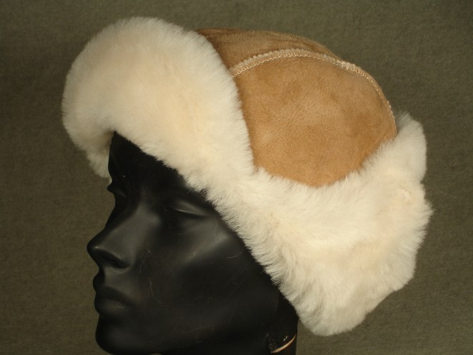 natural sheepskin Mountie hat with flaps and bill up