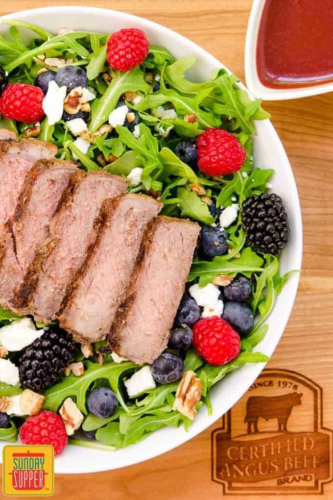 Summer Berry Steak Salad with homemade Berry Balsamic Vinaigrette has fresh berries, feta cheese, and pecans. Use leftover grilled steak for a speedy weeknight meal.