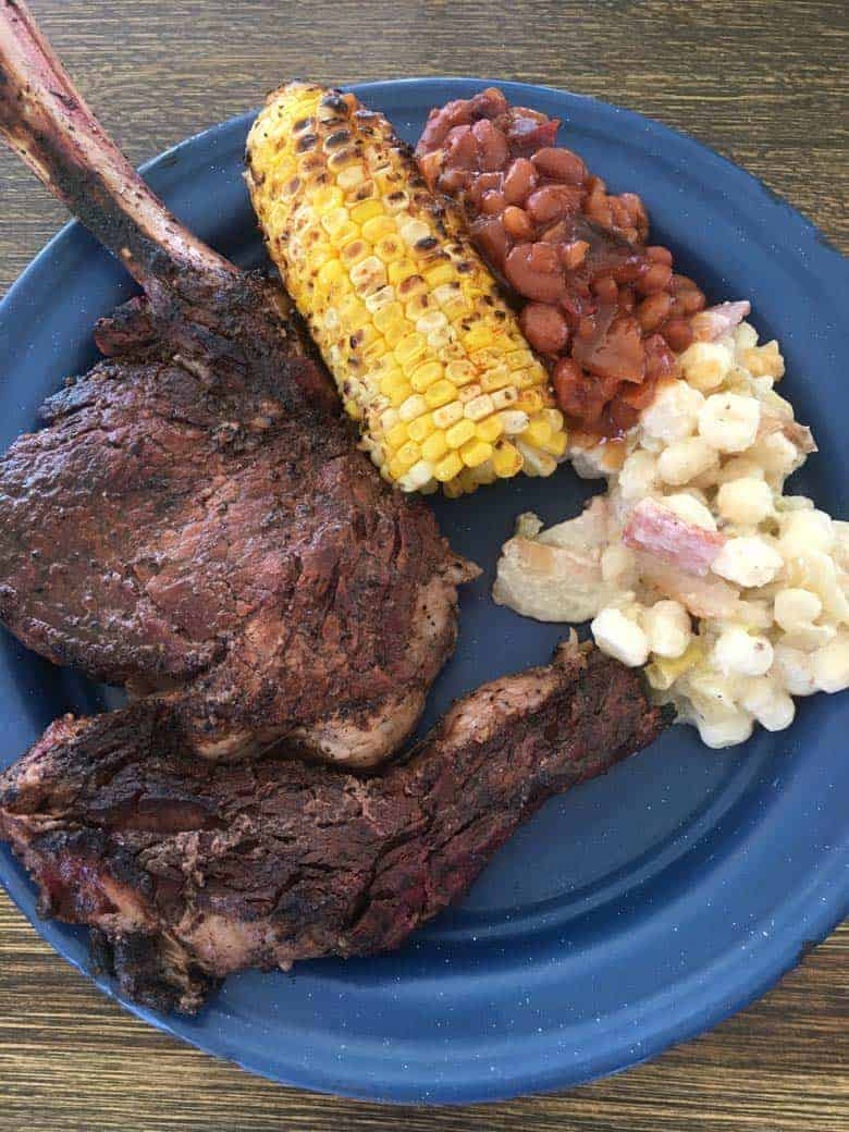 Cowboy steaks and BBQ beans chuck wagon dinner on the ranch in Kansas.