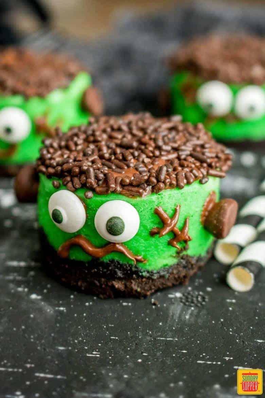 Mini halloween cheesecakes on a black surface