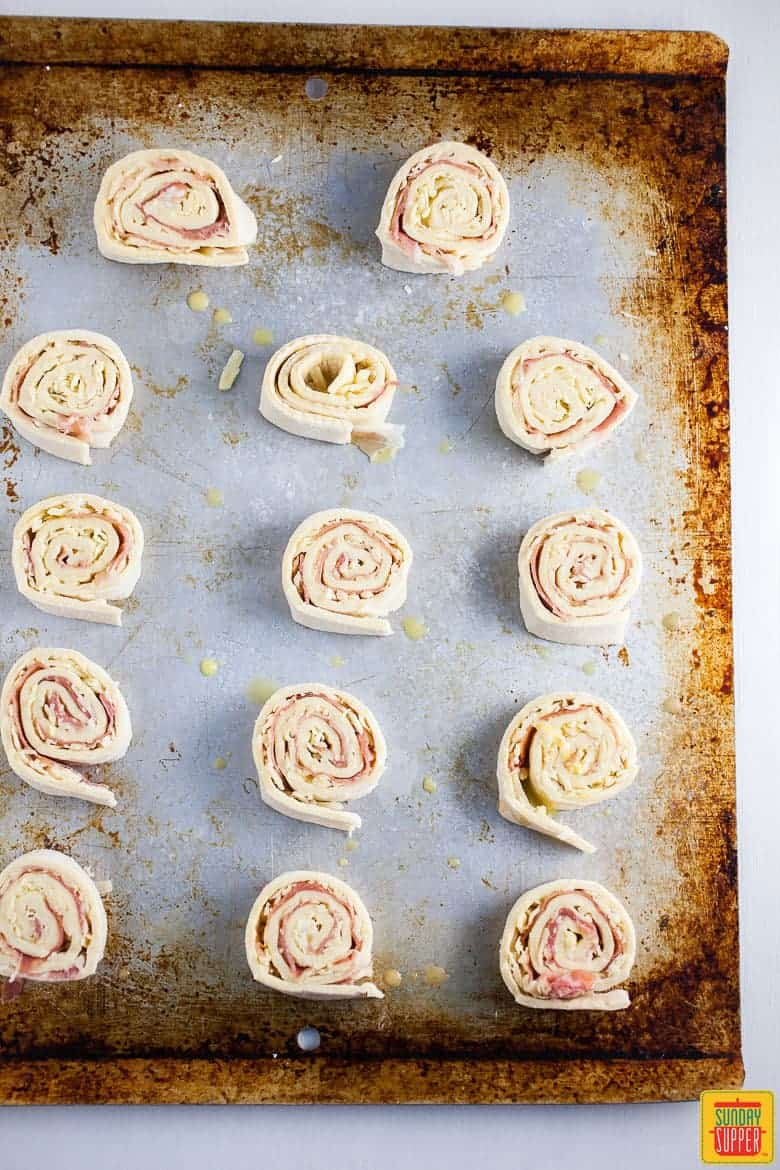Prosciutto Pinwheels with Gruyere and Puff Pastry rolled up and ready to bake