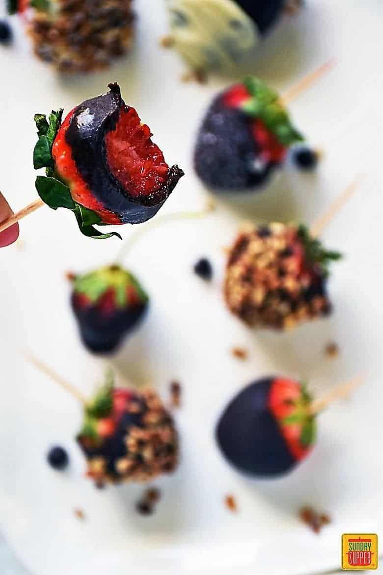 Chocolate Ganache Covered Strawberry with a bite taken out of it