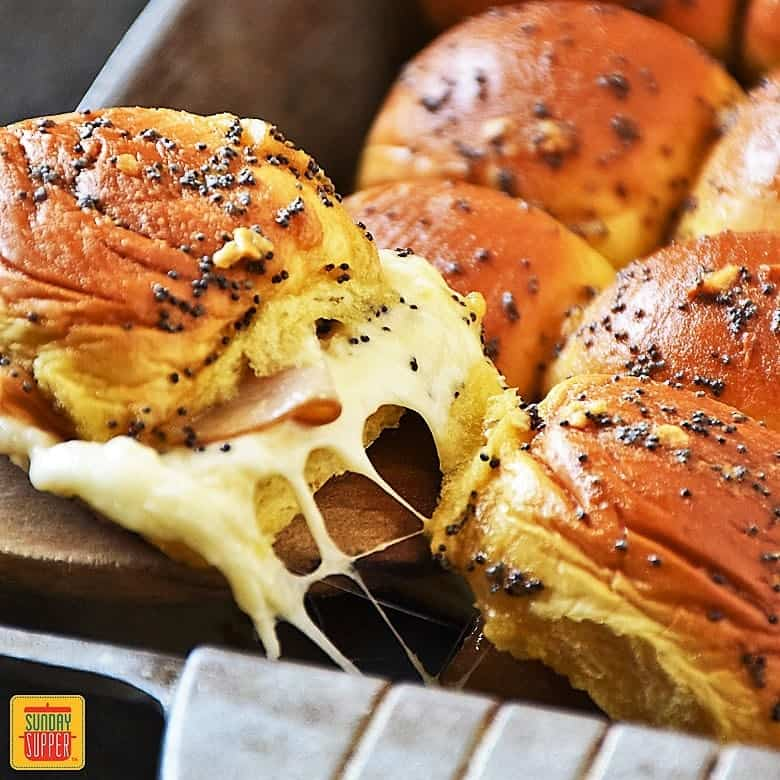Serving a cheesy pull apart Turkey Slider right from the pan full of our turkey sliders recipe