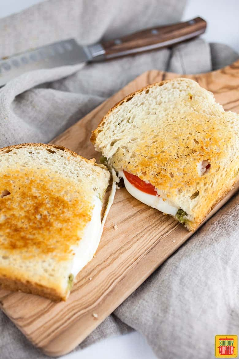 Pesto Grilled Cheese on a cutting board ready to serve #SundaySupper