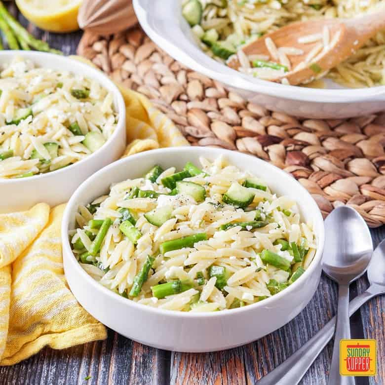 Lemon Orzo Pasta Salad served in white serving bowls and ready to eat