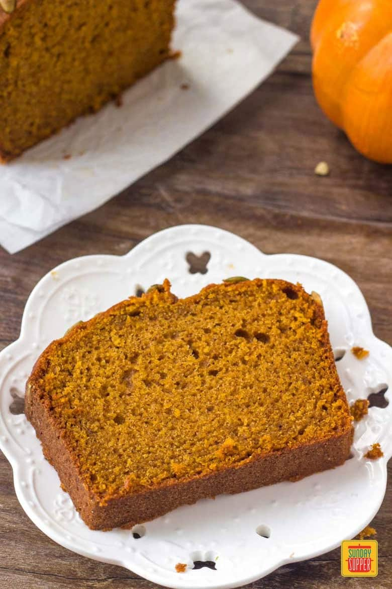 A slice of moist starbucks pumpkin bread.