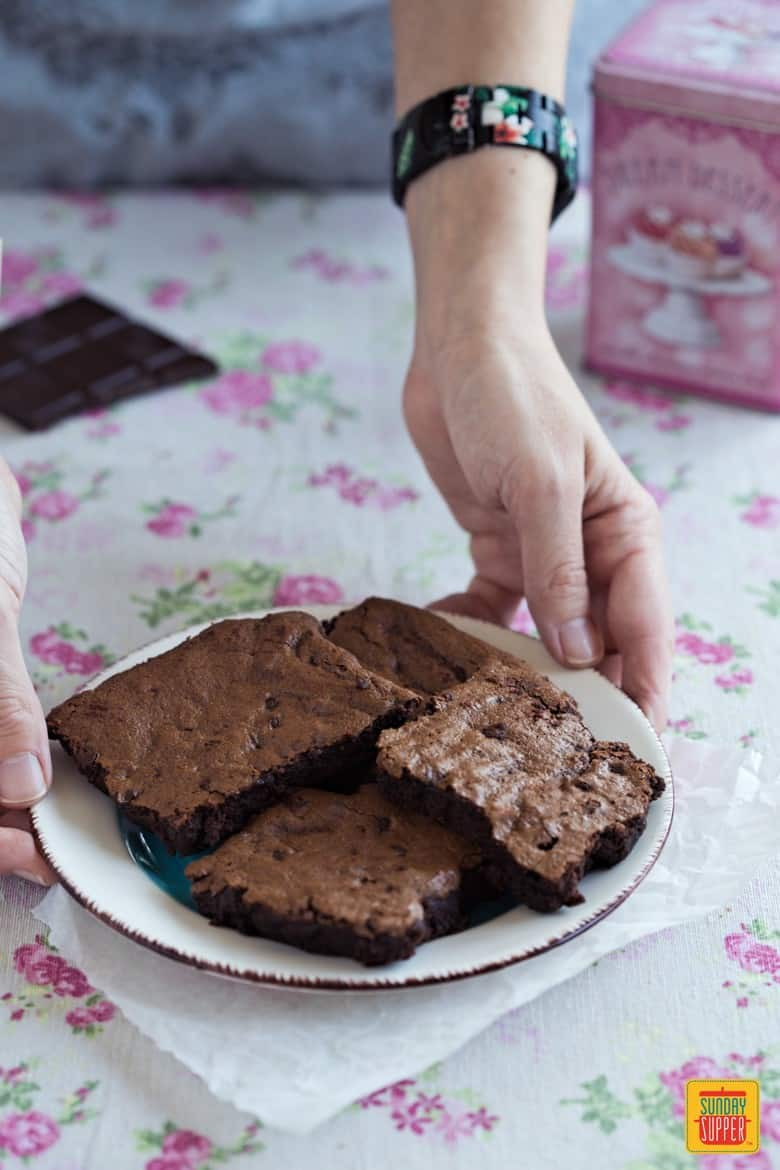 Gluten Free Fudge Brownies being served on a white plate