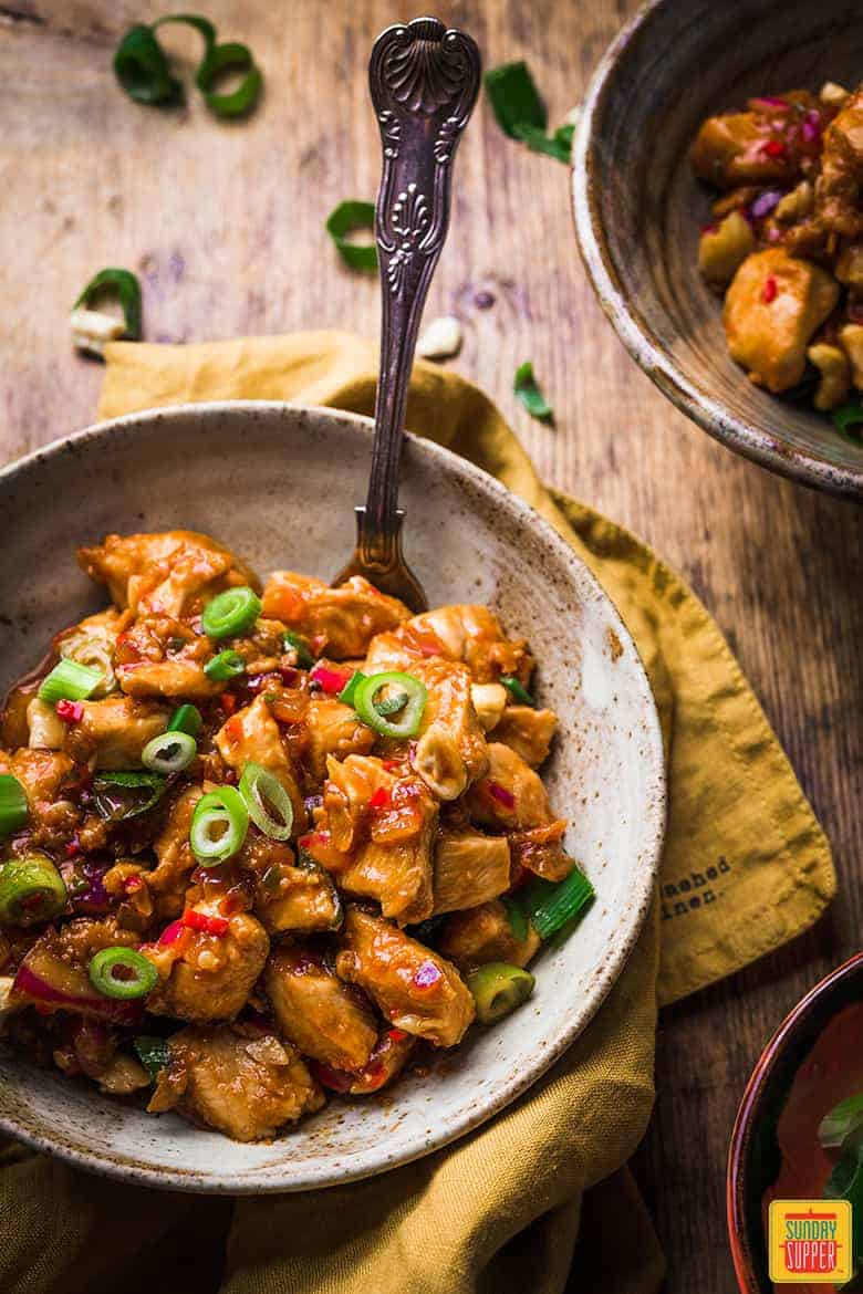 Chinese Dragon chicken recipe in a bowl with a fork ready to enjoy