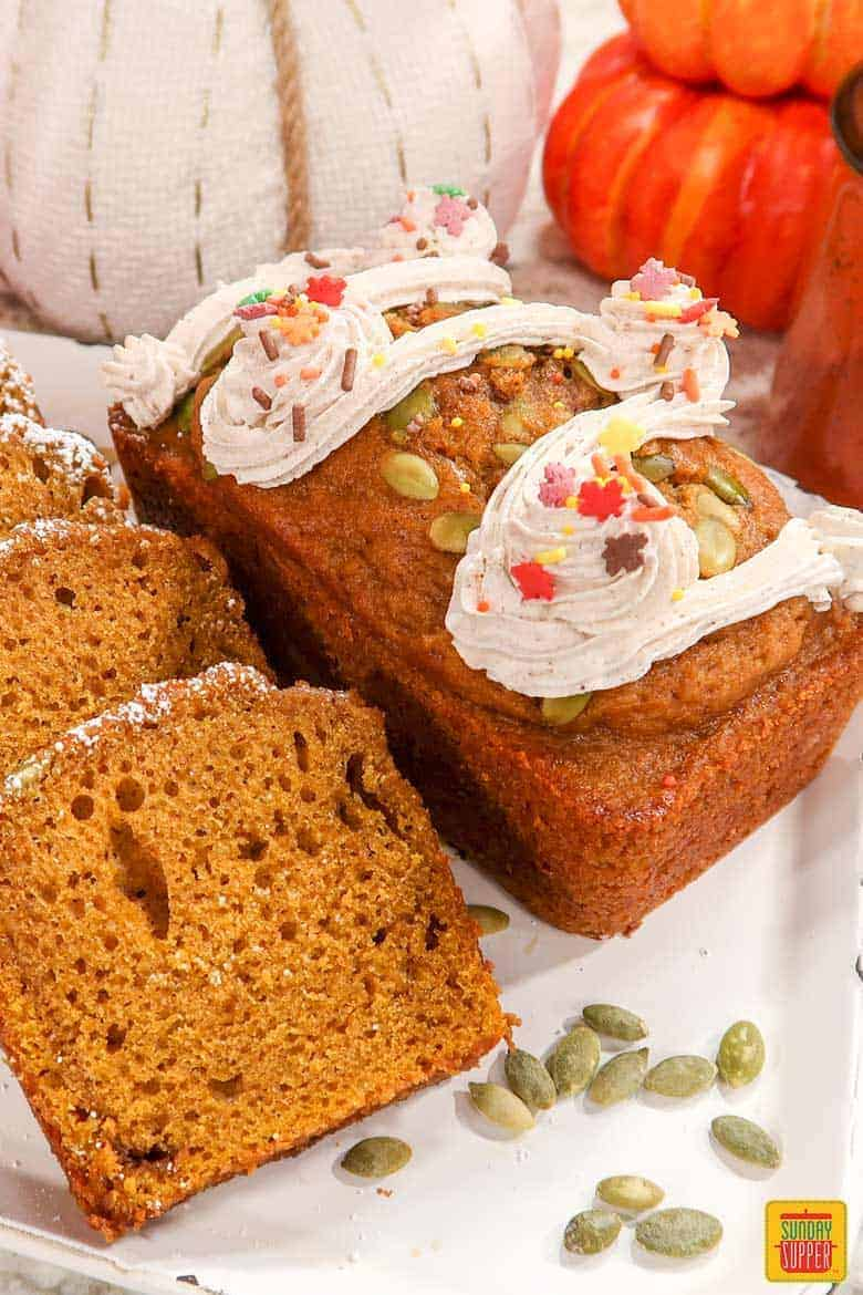 Starbucks pumpkin bread mini loaf with slices on white platter