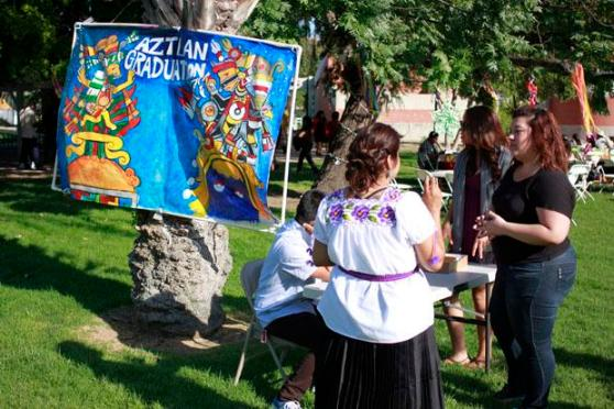 Students gather in front of the registration table for CSUN's Aztlan Graduation Ceremony for the Spring 2013 which was held on May 18 on the side of the Chicano House on campus. Featured keynote speaker was Dr. Christina Ayala-Alcantar. Photo credit by Luis Rivas/Opinions Editor