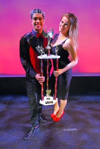 Mr. CSUN winner, Jesus Perez, stands next to his coach, Nicole Nisim, at the annual Mr. CSUN pageant held in the Plaza del Sol Performance Hall on Friday. Photo credit: Michael Arvizu / Daily Sundial