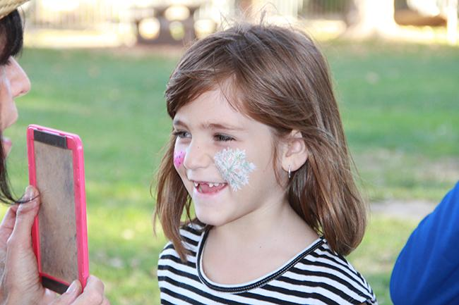 Mackenzie Penner, had her face painting done at the Family Fun Zone. The event welcomed children of CSUN staff and students. Face painting, a animal petting station, food, and games were offered to everyone who attended.  Photo Credit: Victoria Lopez/Contributor