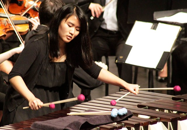 """Percussionist Jieun Chung performs one of two solos during the """"Concerto for Marimba and Strings"""" portion of the Oct. 1 concert. Photo Credit: Luis Garcia/ Contributor"""