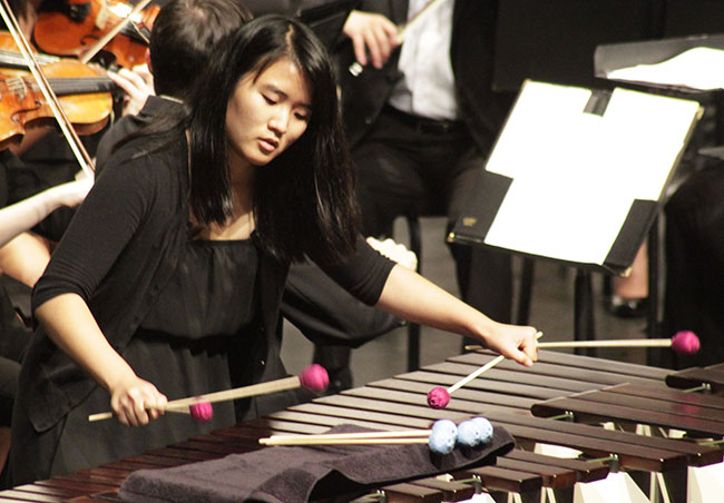 "Percussionist Jieun Chung performs one of two solos during the ""Concerto for Marimba and Strings"" portion of the Oct. 1 concert. Photo Credit: Luis Garcia/ Contributor"