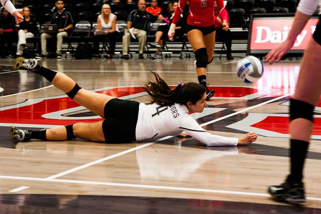 Freshmen Katie Sato, makes an incredible pancake save, ending the night with 8 digs, against Cal State Fullerton. Photo Credit: Kelly Rosales/Contributor