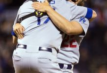 Two Dodgers celebrate together.