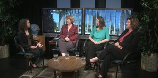 Four females sit and speak to one another
