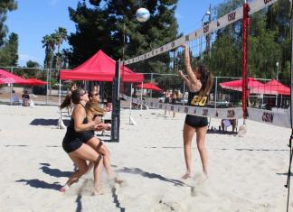 Athletes participate in a game of volleyball