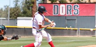 CSUN baseball athlete bats at home base