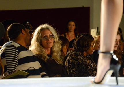 People gaze up at model on the runway