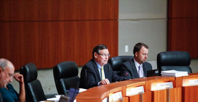 2 chancellors pictured at board meeting