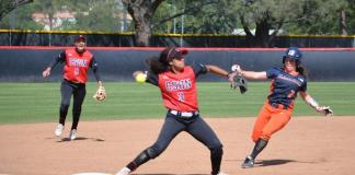 CSUN softball player throws the ball