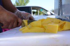 Vendor cuts up mango