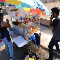 Vendor prepares fruit