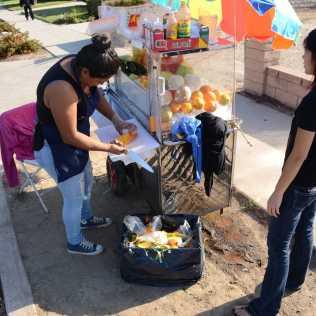 Vendor cuts up papaya