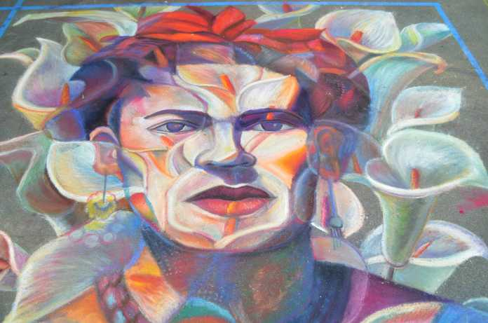 Chalk portrait of Frida Kahlo made of flowers