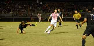 CSUN soccer player keeps control of the ball