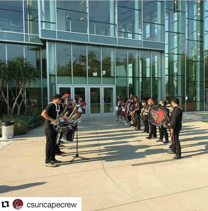 Matador band is lined up outside of VPAC
