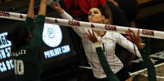 CSUN volleyball player hits the ball