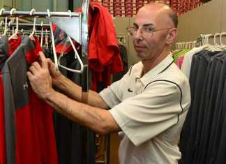 Izzy checking each individual uniform to make sure there are no imperfections