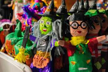 Various pinatas of jackolanterns and witches pictured