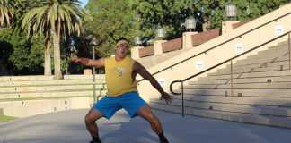 Baseball player dances at Oviatt Library