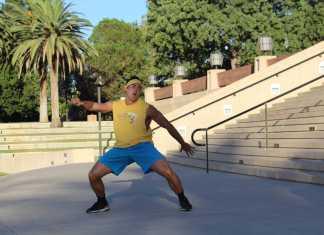 Baseball player dances at Oviatt Library