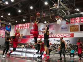 CSUN basketball player shoots for a basket