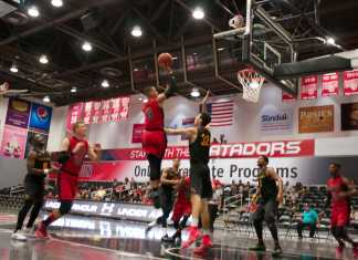 CSUN basketball player shoots for a basket