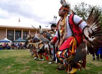 Natvie Americans dance on the Oviatt Lawn