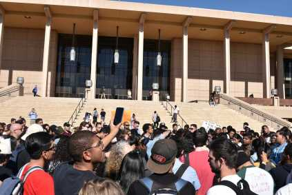 Protesters gather in front of the Oviatt Library
