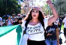 Students march in protest of Trump's election holding up Mexican flag