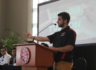 Sevag Alexanian speaks at podium